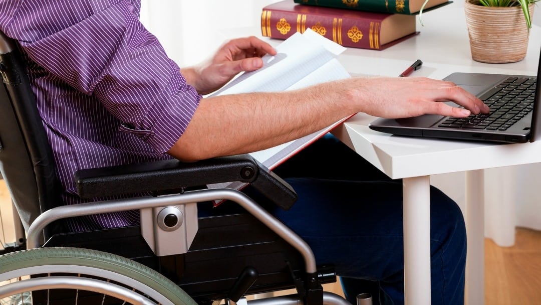 man on wheelchair - online learning
