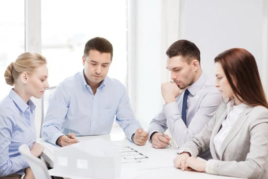 business, architecture and office concept - concerned team of architects and designers in office
