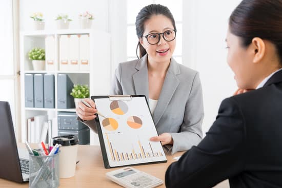 young attractive woman manager introducing company marketing analysis report document for her cooperation case partner in order to get client trust.